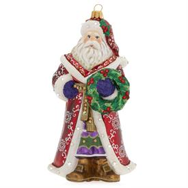 "-SANTA WITH WREATH GLASS ORNAMENT. 3.75"" WIDE, 3"" DEEP, 6"" TALL"