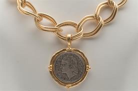 -SILVER COIN IN HANDCAST GOLD FRAME ON LARGE GOLD CHAIN NECKLACE