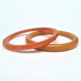 ",SET OF 2 BUTTERSCOTCH & MARBLED FACETED BUTTERSCOTCH BAKELITE BANGLES. .2"" & .3"" WIDE, 2.5"" ACROSS AT INTERIOR DIAMETER"