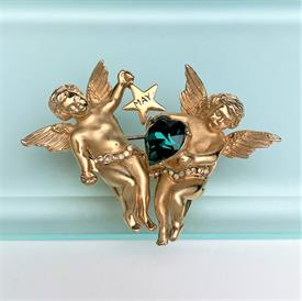 ",SIGNED EISENBERG ICE BROOCH & CLIP-ON EARRING SET IN CLEAR RHINESTONES. BROOCH 1.6"" WIDE, 2.25"" LONG. EARRINGS 1.5"" LONG"