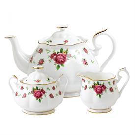 -3-PIECE TEA SET. INCLUDES TEA POT, CREAMER, & SUGAR BOWL WITH LID. HAND WASH.