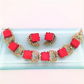 ",1960'S SIGNED CORO THERMOSET LUCITE BRACELET & CLIP-ON EARRING SET IN RED & GOLD LEAF DESIGN. BRACELET MEASURES 7"" LONG"