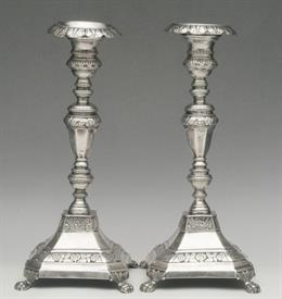 ",FOOTED CANDLESTICK PAIR MADE IN PORTO, PORTUGAL CIRCA 1843-1853. FAIR CONDITION, DENTED & LOP-SIDED, PLEASE SEE PHOTOS. 9.5"" TALL"