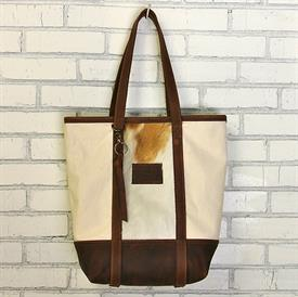 -,KODIAK BIG BUCKET BAG IN CREAM WITH GOLDEN HIDE. ALL HIDES WILL VARY IN COLOR