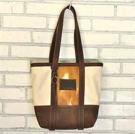 -,KODIAK LITTLE BUCKET BAG IN CREAM WITH GOLDEN HIDE. ALL HIDE COLORS WILL VARY