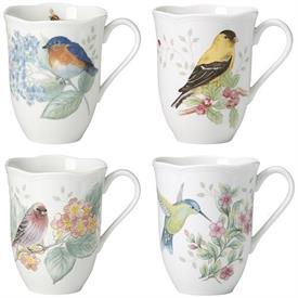-4-PIECE ASSORTED MUG SET. 12 OZ. CAPACITY. MICROWAVE & DISHWASHER SAFE. BREAKAGE REPLACEMENT AVAILABLE. MSRP $72.00