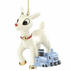"_,2018 RUDOLPH THE RED-NOSED REINDEER ORNAMENT. 'RUDOLPH'S MISFIT FRIEND', RUDOLPH WITH TOY TRAIN. 3.5"" TALL. MSRP $60.00"