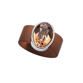 -,SMALL TOPAZ CRYSTAL ON BROWN RUBBER BAND RING. FITS APPROX. SIZE 7. APPROX. 8 CARAT SWAROVSKI CRYSTAL