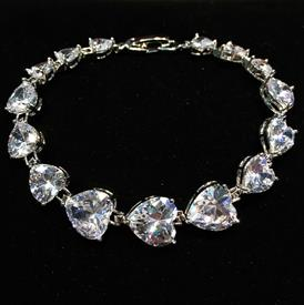 "-,CLEAR GRADUATED HEART CZ BRACELET. 7"" LONG"