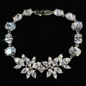 "-,CLEAR CZ FLOWERS BRACELET. 6.75"" LONG"