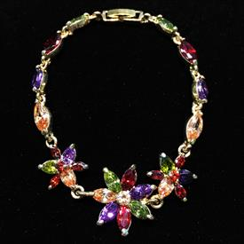 "-,MULTI GEMSTONE COLORED CZ IN GOLD TONE METAL FLOWER BRACELET. 7.25"" LONG"