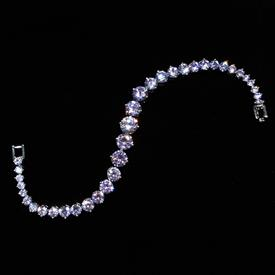 "-,GRADUATED PALE AMETHYST CZ BRACELET. 6.75"" LONG"