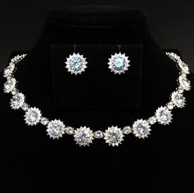 "-,CLEAR CZ 'SUNS' NECKLACE & EARRING SEST. 16.6"" LONG, .5"" WIDE NECKLACE. .5"" WIDE POSTS."
