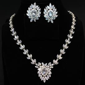 "-,CLEAR CZ 'CLUSTERS OF LEAVES' NECKLACE & EARRING SET. 16.75"" LONG NECKLACE WITH 1.25"" DROP. 1.25"" LONG, .9"" WIDE LEVER BACK EARRINGS"