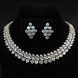 "-,CLEAR ROUND CUT CZ NECKLACE & EARRING SET. 16.2"" LONG, .65"" WIDE NECKLACE. 1"" LONG, .75"" WIDE EARRINGS"