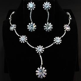 "-,CLEAR CZ SUNBURST NECKLACE & EARRING SET. 17.2"" NECKLACE WITH 2"" DROP. 2"" LONG, .65"" WIDE EARRINGS"