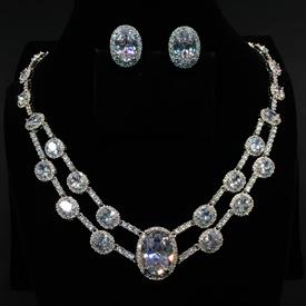 "-,LARGE CLEAR OVAL CZ NECKLACE & EARRING SET. 18.3"" LONG NECKLACE WITH .8"" CENTER STONE. .75"" LONG, .55"" WIDE LEVER BACK EARRINGS"