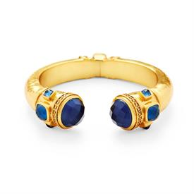 _HINGED CUFF BRACELET IN SAPPHIRE BLUE. FACETED GLASS GEMSTONE ENDCAPS IN LIGHTLY HAMMERED & BEADED 24K GOLD PLATE. HINGED TO FIT ALL WRIST