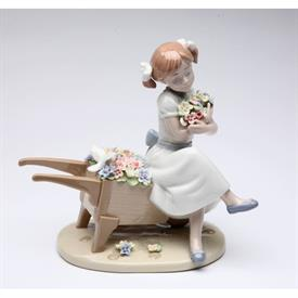 "-,'CUDDLE ME WITH BLOSSOMS' GIRL AND DOVE ON WHEELBARROW OF FLOWERS FIGURINE. 6.25"" TALL, 6.2"" LONG, 3.75"" WIDE"