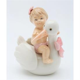"-BABY GIRL ON STORK FIGURINE. 3.5"" LONG, 2.2"" WIDE, 3.4"" TALL"