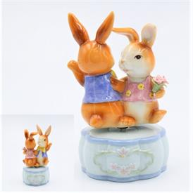 "-,DANCING BUNNIES MUSIC BOX. PLAYS 'IT'S A SMALL WORLD'. 3.25"" WIDE, 5.4"" TALL"