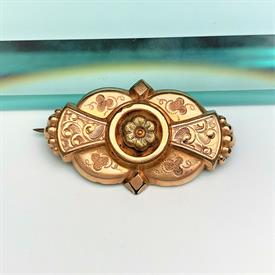 ",VICTORIAN ERA ROSE & YELLOW GOLD FILLED FILIGREE FLOWER BROOCH/PENDANT. 1.25"" LONG, .75"" TALL."
