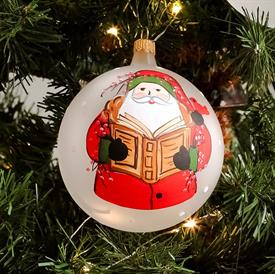"-SANTA READING GLASS ORNAMENT. 4"" WIDE"