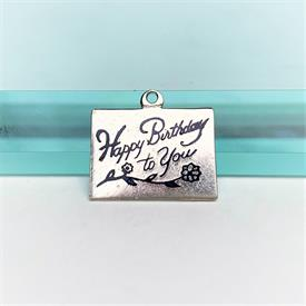 ",VINTAGE STERLING SILVER & BLUE ENAMELED 'HAPPY BIRTHDAY TO YOU' CHARM WITH FLOWER. .75"" WIDE, .6"" LONG"