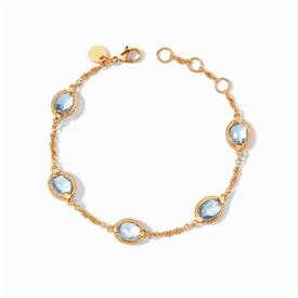 -,CHALCEDONY BLUE DELICATE BRACELET. FACETED OVAL GLASS GEMSTONE STATIONS IN A 24K GOLD PLATED CHEVRON SURROUND ON A SLENDER CHAIN. ADJUSTAB