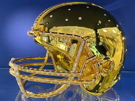 -Football Helmet of bling by Crystamas dripping in gold is is bedazzled in over 800 Swarovski round and baguette diamond cut Chatons