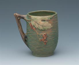 ",BUSHBERRY GREEN MUG #1-3 1/2. 3.75""T X 3""D."